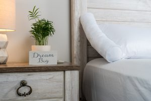 Cosy Case on bed with dream big sign on nightstand